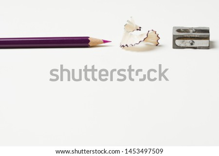 Pencil with pencil shavings and sharpener #1453497509
