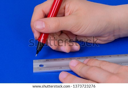 Pencil with ruler boy draws and measures