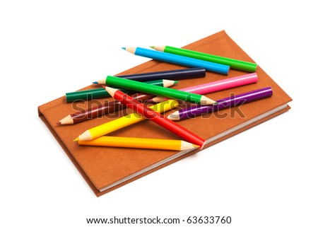 pencils and a notebook on a white background