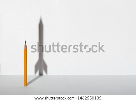 Pencils and a shadow in form of spacecraft . Success, cureer and solving problems business concept. Copy space for text . Stockfoto ©