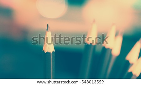 Pencils and blurred focus background  with vintage color tone, abstract business and education