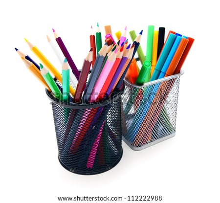 pencils and felt-tip pens in baskets.