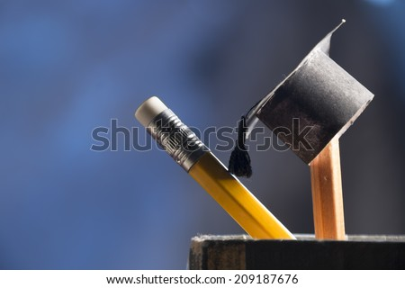 pencils and graduation hat, education concept