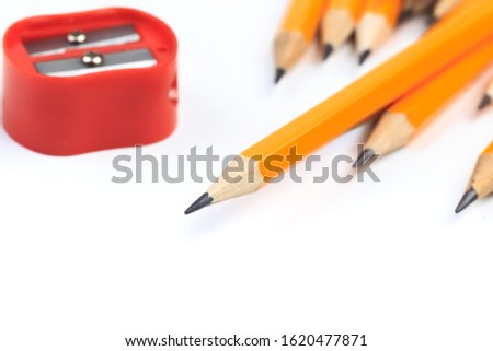 pencils and  pencils sharpener  isolated on white