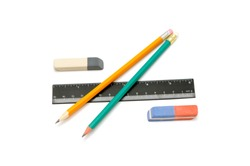 Pencils, eraser and ruler on a white background