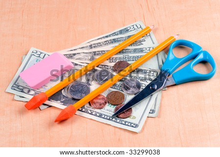 Pencils eraser and scissors with paper and coin money
