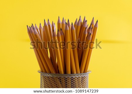 Pencils on yellow background #1089147239
