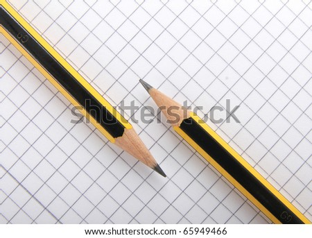 pencils parallel to each other on sheet of squared