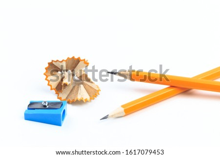 pencils, pencils sharpener and the shavings, isolated on white