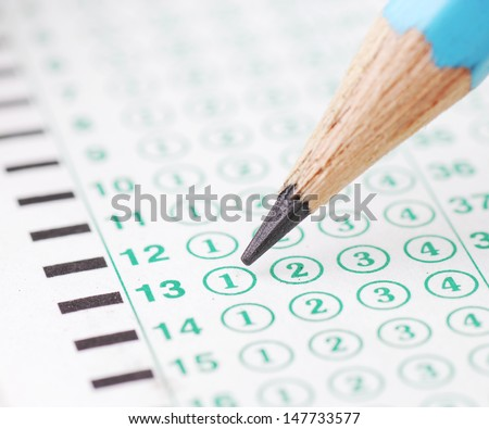 Pencils point at choice No. 1  on blank test sheet close up
