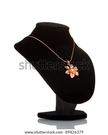 Pendant in form of flower on mannequin isolated on white