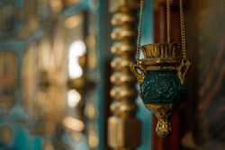 pendant oil lamp in the orthodox church.flame in the temple. oil lamp on the wall. religious paraphernalia. Orthodox Church. wedding of the newlyweds - details. oil lamp - close-up.