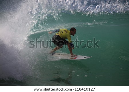 PENICHE, PORTUGAL - OCT 13: CJ Hobgood tube riding a wave in round 1, heat 11 at WCT contest, Rip Curl Pro in Peniche, Portugal on October 13, 2012