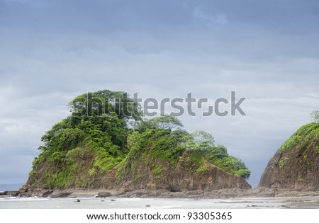 Peninsula with cliffs and tropical trees - Punta Leona, Costa Rica