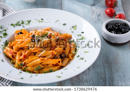 penne all arrabbiata and pasta, tomato, olive on the light blue background ストックフォト ©