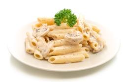 penne pasta carbonara cream sauce with mushroom isolated on white background