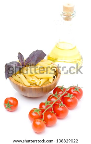 penne pasta, fresh tomatoes, basil, olive oil isolated on white background
