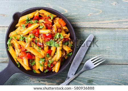 Penne pasta in pan with space for text .