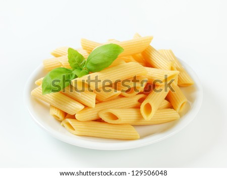Penne pasta on a white plate