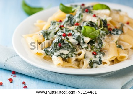 Penne pasta with blue cheese sauce and spinach