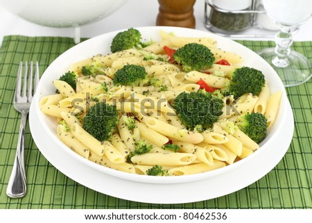 Penne pasta with broccoli on a plate/