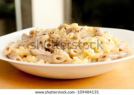 penne pasta with melted cheese, a take-off of classic macaroni and cheese with whole wheat pasta and aged white cheddar