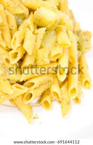 Penne with pesto and zucchini on a white background #691644112