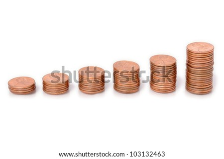 Pennies Arranged as a Bar Graph. Stacks of pennies arranged to represent a bar chart. - stock photo