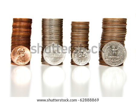 Pennies, nickels, dimes and quarters neatly stacked together isolated on white.