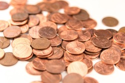 Pennies Scattered on White Background