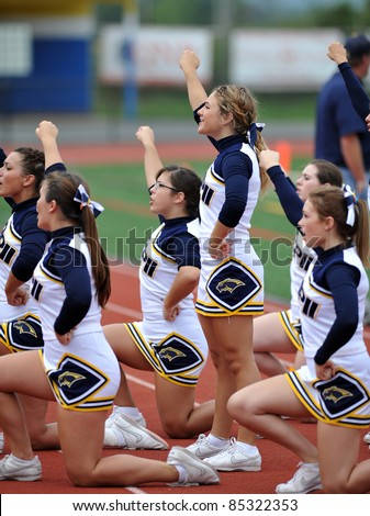 PENNSBURG, PA - SEPTEMBER 24: Members of the Pope John Paul II high school cheerleading squad entertain the crowd during the PAC10 conference game against Methacton September 24, 2011 in Pennsburg, PA