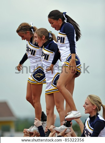 PENNSBURG, PA - SEPTEMBER 24: Members of the Pope John Paul II high school cheerleading squad entertain the crowd during the PAC10 conference game against Methacton September 24, 2011 in Pennsburg, PA - stock photo