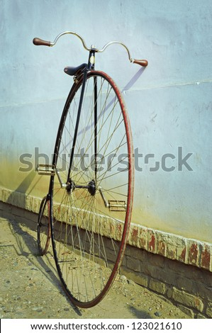 Penny farthing ,high wheel,bicycle,retro,vertical - stock photo