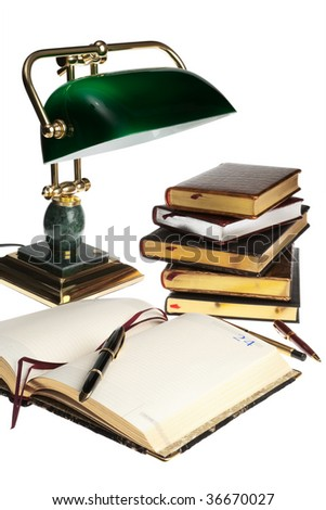 pens, books and a lamp on a white background