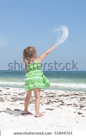 PENSACOLA BEACH - JUNE 23: An unidentified young girl plays with sand near oil patches on June 23, 2010 in Pensacola Beach, FL.