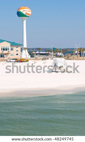 PENSACOLA BEACH - MARCH 3: Pensacola Beach, Florida with its emerald water and white beaches is a popular vacation resort, seen here on March 3, 2010 prior to the influx of Spring Break tourists. - stock photo
