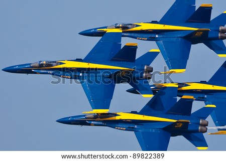 PENSACOLA, FL - NOVEMBER 11: The US Navy Blue Angels in F-18 Hornet planes perform in air show routine in Pensacola, FL on November 11, 2011. The Blue Angels are the oldest active aerobatic team in the world.