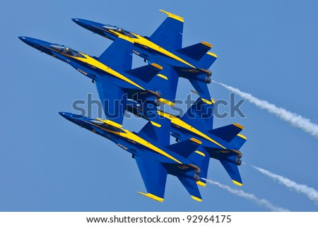 PENSACOLA, FL - NOVEMBER 11:US Navy Blue Angels in F-18 Hornet planes perform in air show routine in Pensacola, FL on November 11, 201. Blue Angels are the oldest active aerobatic team in the world