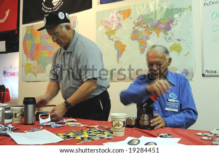 PENSACOLA, FLA - OCT 22: Volunteers at the Veterans for McCain campaign office in Pensacola, Florida, printing campaign buttons in fast tempo on October 22, 2008, as election day approaches.