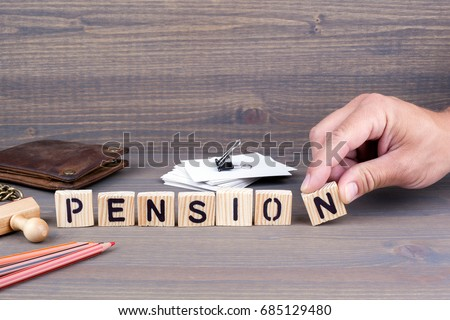 pension. Wooden letters on dark background
