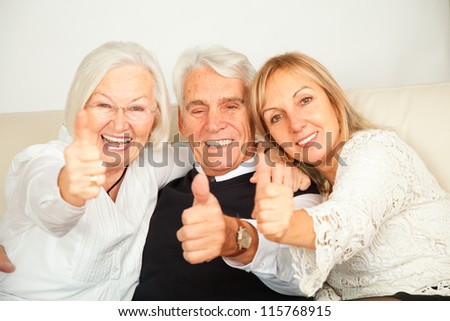 pensioner couple and daughter