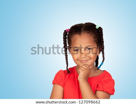 Pensive african girl isolated on a blue background