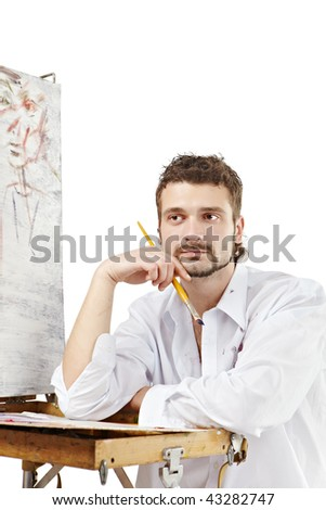Pensive artist invents a new image. Isolated over white