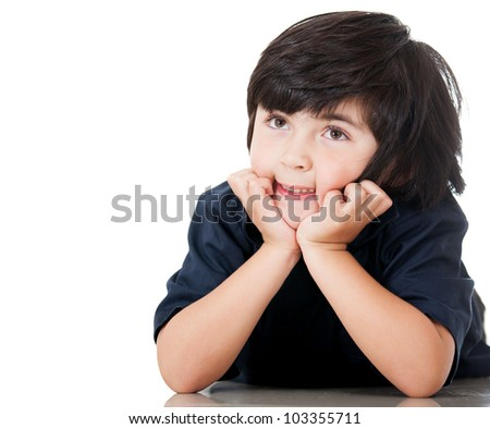 Pensive boy looking up - isolated over a white background