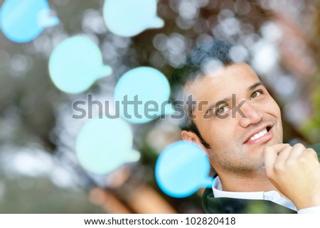 Pensive business man with thought bubbles around his head