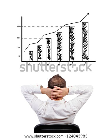 pensive businessman looking at chart of profit