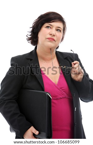 Pensive businesswoman standing looking up to the sky with her glasses against her chin making difficult business decisions