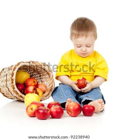 pensive child with healthy food red apples