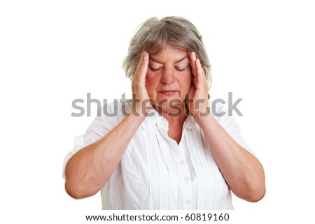 Pensive elderly woman holding hands to her temples