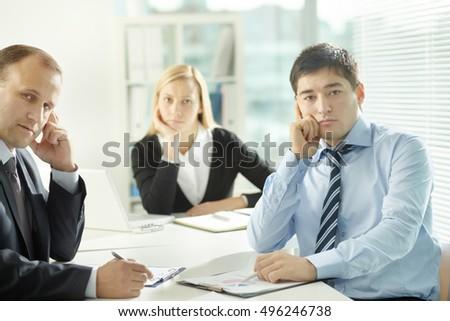Pensive employees  - Shutterstock ID 496246738